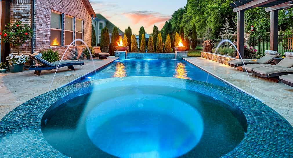 Spa, pergola and fire features with a formal pool