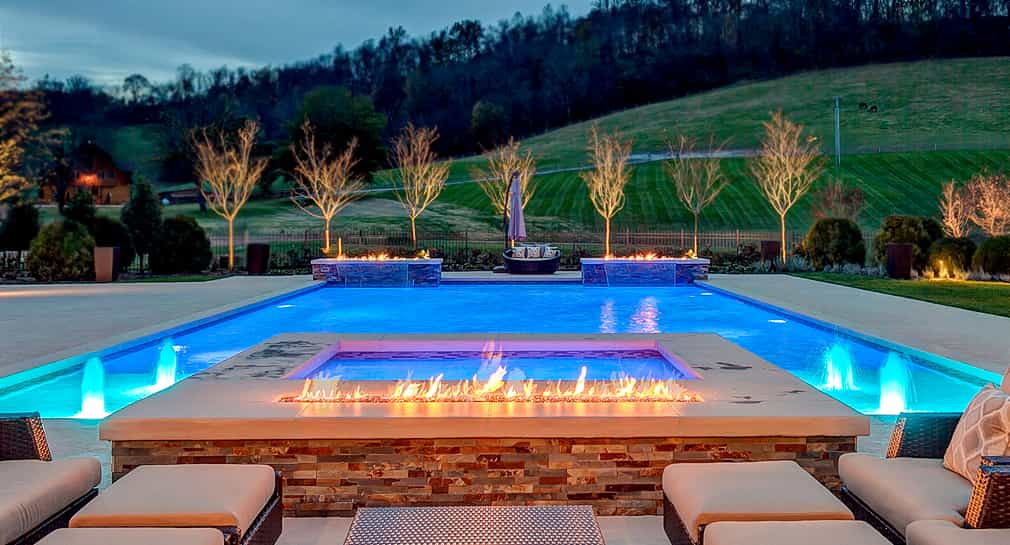 Formal pool with fire features, night lighting and fountains