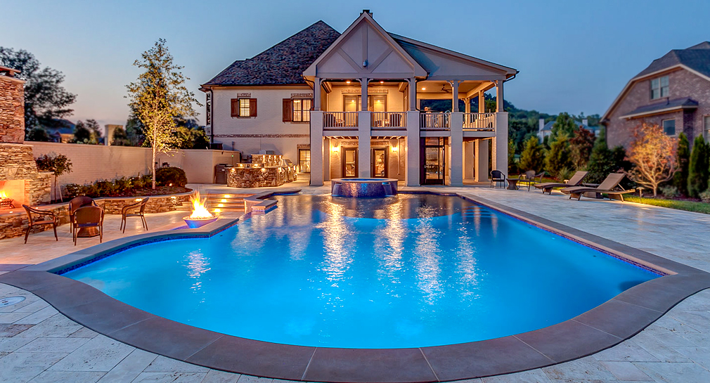 Formal pool with fireplace, fire features and an outdoor kitchen