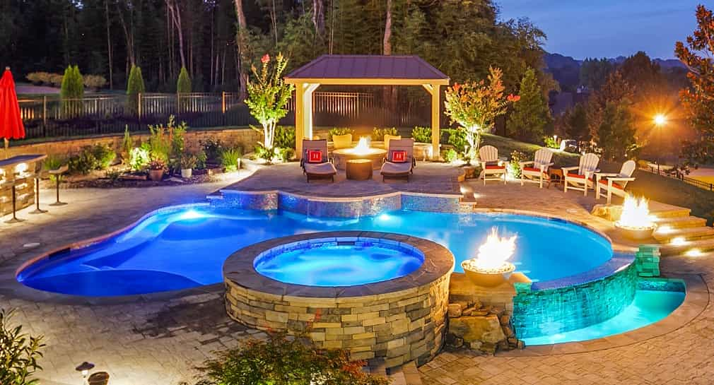 Freeform custom pool area with spa, waterfall and lounge pavillion