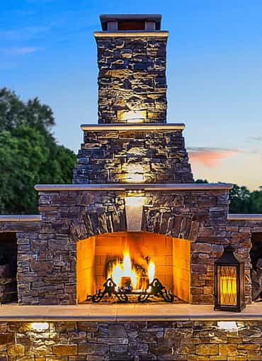 Custom outdoor living space with a fireplace