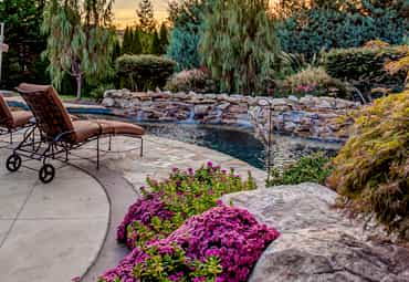 Natural custom pool with unique landscaping