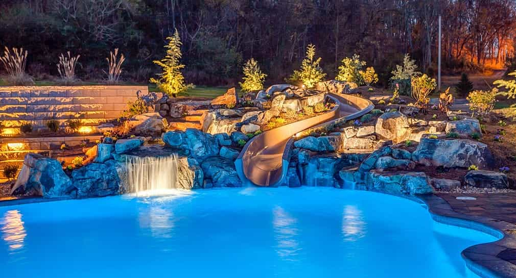 Slide, waterfall and lighting at a custom Peek Pool