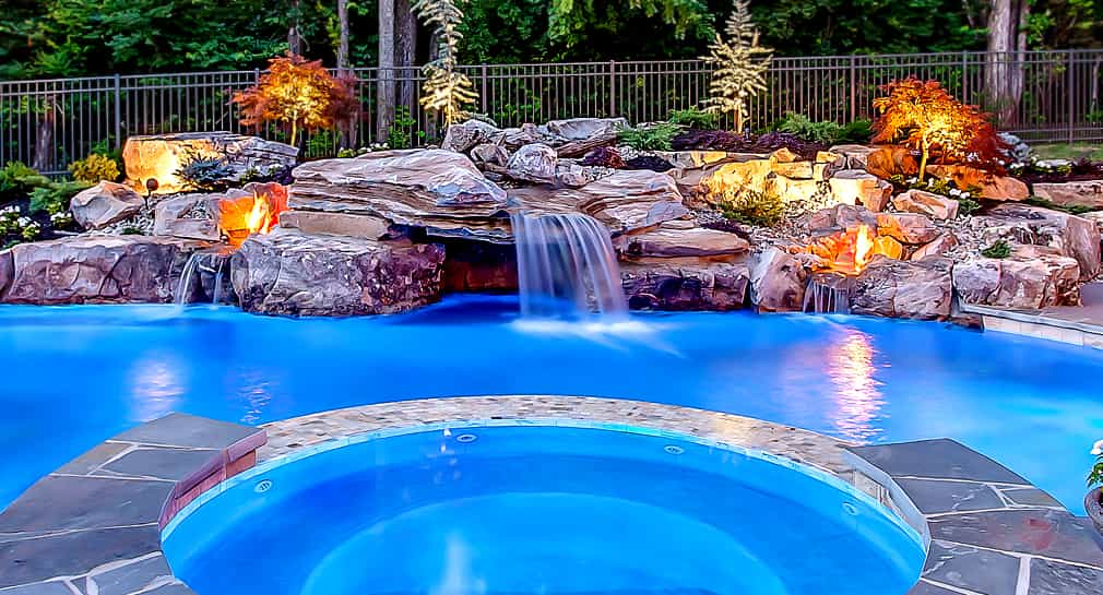 Natural looking rock waterfall, fire feature and landscaping