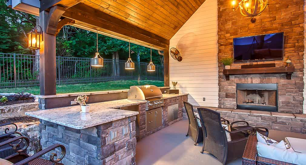 Covered poolside kitchen and entertainment area