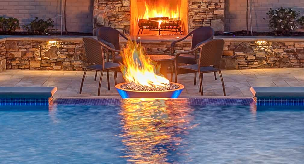 Fire feature and fireplace near the custom pool