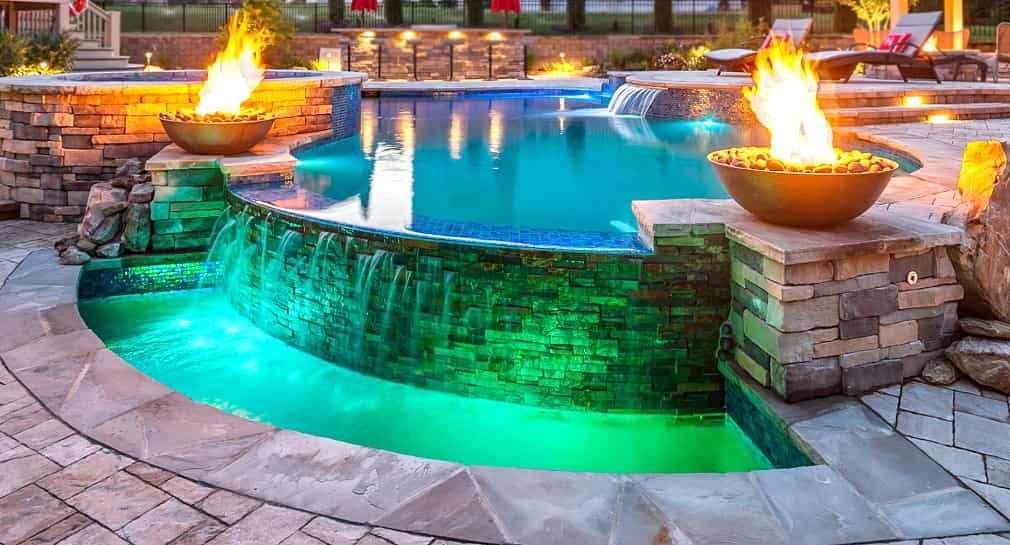 Infinity edge pool, fire features, and special lighting