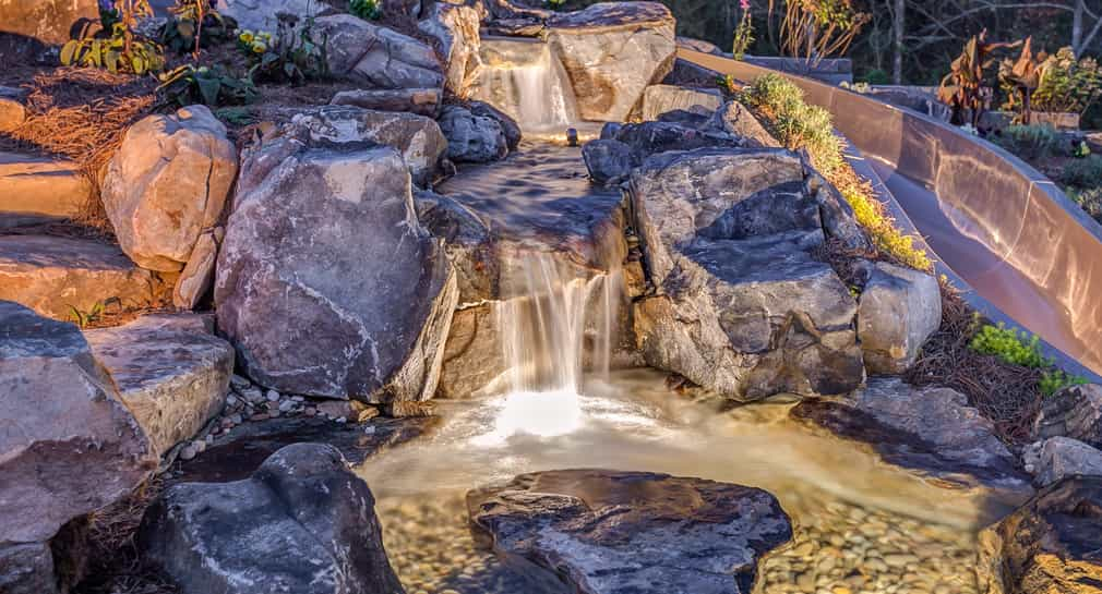 Natural stone waterfall and slide